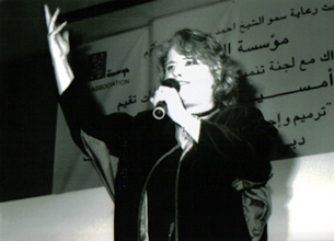 Reem Kelani performing at a Welfare Association fundraiser